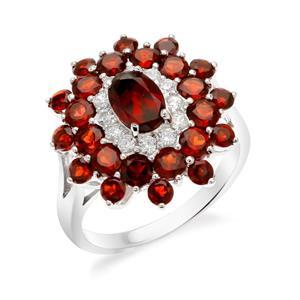 แหวนโกเมน เงินแท้ 925 ชุบทองขาวประดับ รูปแบบดีไซน์ที่หรูหรา ดูเป็นผู้ดี เพิ่มเสน่ห์ พลังอำนาจให้กับผู้สวมใส่  ด้วยพลอยสีแดง โกเมน(Garnet) และ เพิ่มความประกายด้วย คิวบิกเซอร์โคเนีย ( Cubic Zirconia)