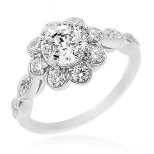 แหวนเพชร DiamondLike  หัวแหวนล้อมด้วยเพชรอีกชั้น เพิ่มขนาดให้กับเพชรหัวแหวน ตัวเรือนเงินแท้ชุบทองคำขาว