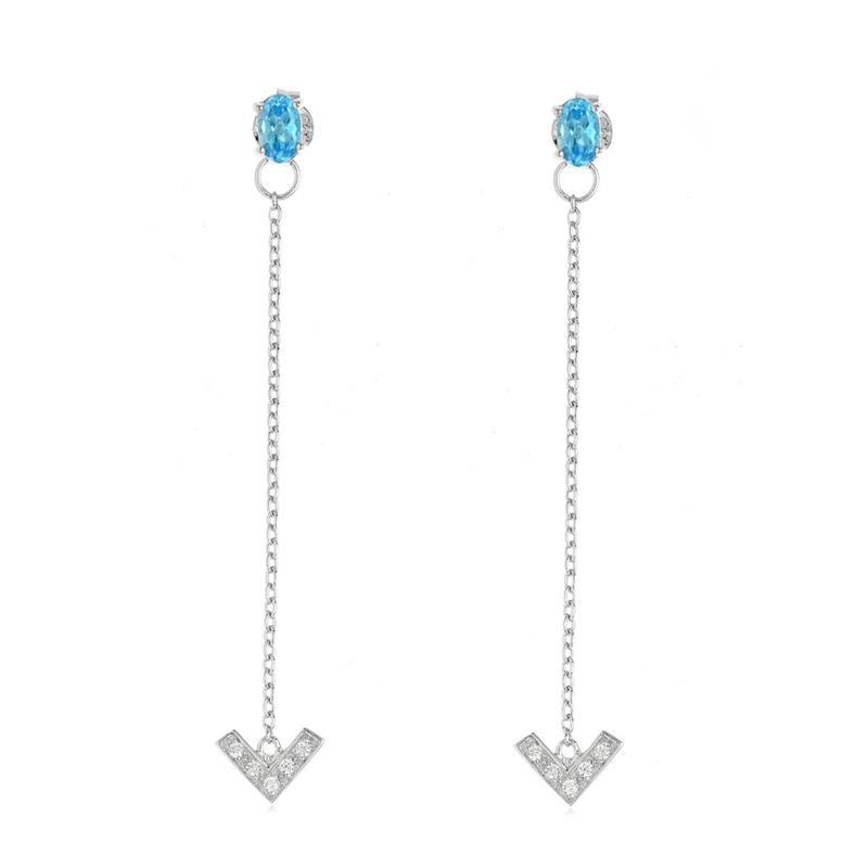ต่างหูสร้อยตุ้งติ้งบลูโทแพซ(Blue Topaz) สีฟ้า และ คิวบิกเซอร์โคเนีย (Cubic Zirconia) ตัวเรือนเงินแท้ 925 ชุบทองขาว อัพใบหน้าสวยเด่น ด้วยต่างหูคู่สวย